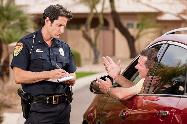 Man Receiving a Driving Ticket