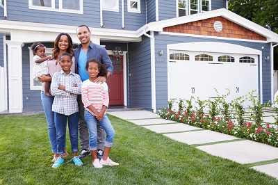 image of family standing in front of house