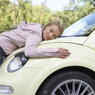 image of teen hugging car